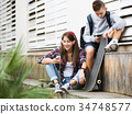 Friends relaxing with mobile phones 34748577