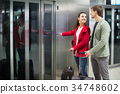 Passengers waiting for lift at subway station. 34748602
