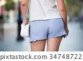 Female buttocks in blue shorts 34748722