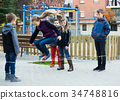 Friendly kids skipping on jumping elastic rope 34748816