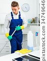 Male professional janitor dusting in office 34749646