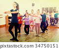 Young ballet dancers exercising in ballroom 34750151