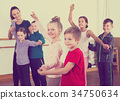 vigorous little boys and girls dancing pair dance 34750634