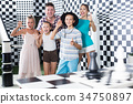 Young family is satisfied of visit 34750897