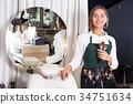 Portrait of adult woman makeup artist 34751634