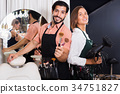 Smiling woman hairdresser and male makeup artist 34751827