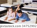 Couple choosing mattress 34752902