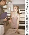 Ordinary seller demonstrating to woman mattress 34752911