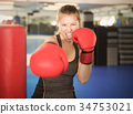 Woman boxing in gym 34753021