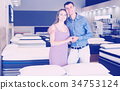 Portrait of family in mattress store 34753124