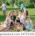 Happy family on picnic outdoors and kids playing 34753165