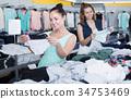 women, choosing, trousers 34753469