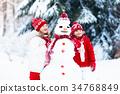 Kids building snowman. Children in snow Winter fun 34768849