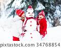 Kids building snowman. Children in snow Winter fun 34768854