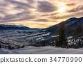 cloudy sunrise over the mountainous rural area 34770990