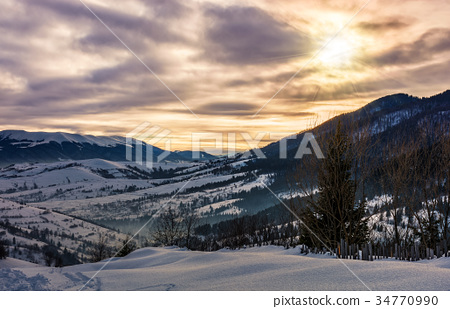 cloudy sunrise over the mountainous rural area 34770990