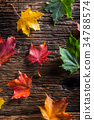 Autumn colorful leaves on rustic wooden table. 34788574