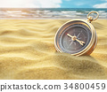 Compass on sea sand. Travel destination  34800459