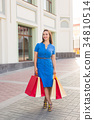After day shopping. Young woman carrying shopping 34810514