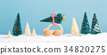 Miniature wooden car carrying a Christmas tree 34820275