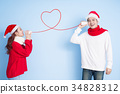 couple smile with merry christmas 34828312