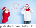 couple smile with merry christmas 34828313