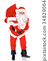 Santa Claus gesticulate while standing straight 34829064
