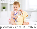 Happy cute baby  at health exam at doctor's offic 34829637