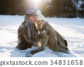 Beautiful senior couple in sunny winter nature. 34831658