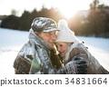 Beautiful senior couple in sunny winter nature. 34831664