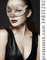 beautiful young woman in mask 34835292