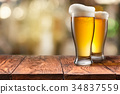 Two Glass of beer on wooden table 34837559