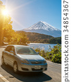 Car driving near Mt Fuji in Japan with motion blur 34854367