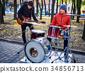 Festival music band. Friends playing on percussion 34856713