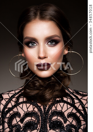 Beauty Brunette Woman with Perfect Makeup 34857018