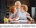 Radiant grandmother embracing her creative 34860765