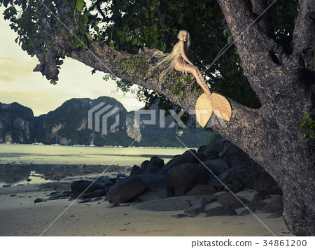 Beautiful mermaid sitting on mighty tree 34861200