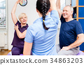 Elderly couple at physiotherapy on gymnastic balls 34863203
