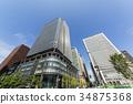 도쿄역 중앙 출구 푸른 하늘과 고층 빌딩 34875368