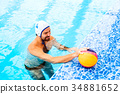 Water polo player in a swimming pool. 34881652