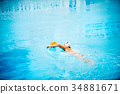 Water polo player in a swimming pool. 34881671