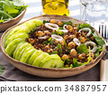 Quinoa salad bowl with cucumbers, chickpeas 34887957