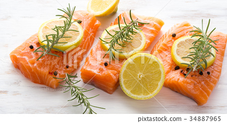 Raw salmon on wooden board with herbs 34887965
