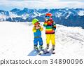 Ski and snow winter fun for kids. Children skiing. 34890096