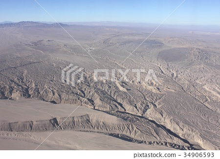 Aerial view of a valley in a desolate high desert area near Calama in northern South America Chile 34906593