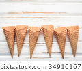 Flat lay ice cream cones collection. 34910167