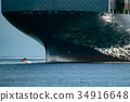 dolphin jumping over ship prow 34916648