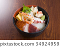Bowl of rice topped with sashimi 34924959