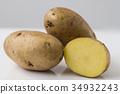 Potato isolated on white background close up 34932243