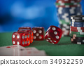 Red dice rotates in the air, casino chips, cards 34932259